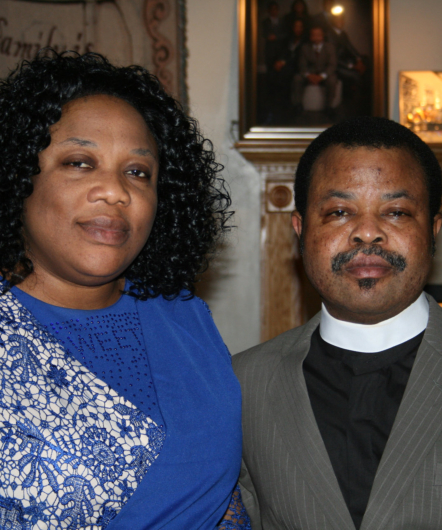 Pastor and a woman wearing blue top